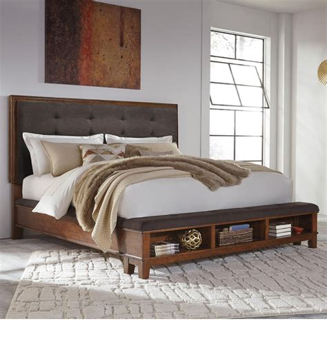 34524 upholstered king bed king upholstered bed with bench storage footboard by
