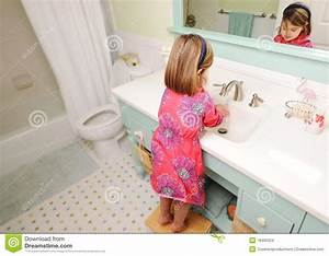 young girl washing hands in bathroom stock images image With girl in the bathroom pics