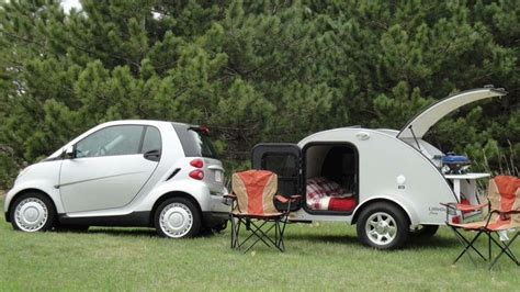 Smart Car And Little Guy Camper