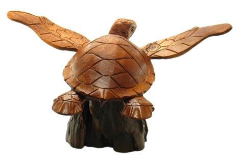 carved wood swimming sea turtle on driftwood base