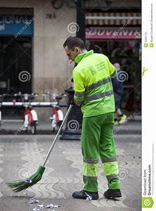 Garbage Man Sweeping The Road. Barcelona, Spain Editorial ...