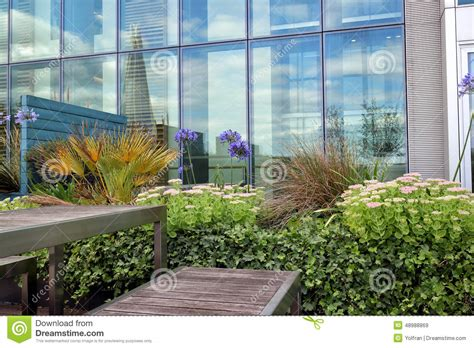top roof terrace with flowers and shrubs and patio