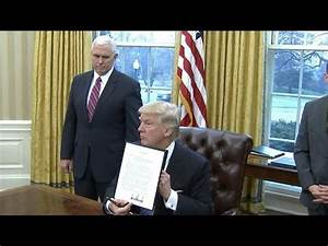 Watch: President Trump signs executive orders, including ...