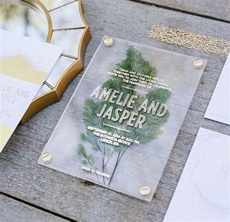 Picture Of an acrylic wedding invitation with a pressed
