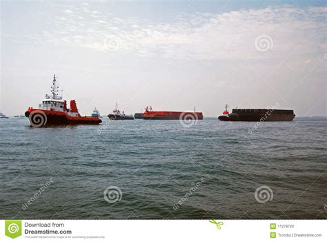 Tug Boat Singapore by Tugs And Barges In Singapore Anchorage Stock Photo