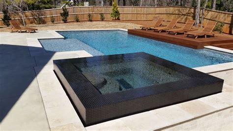 modern pool coping modern pool with tile infinity edge spa our freeform pools pinterest modern pools and spa