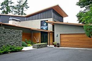 Modern exterior of home with stacked stone wall metal for Exterior paneling for homes