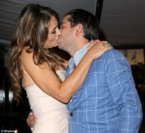 married actress kiss julian bharti pays 163 50 000 to kiss with elizabeth hurley