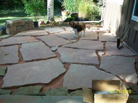 laying a flagstone patio 301 moved permanently