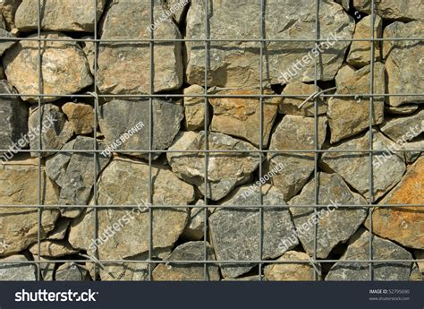 rock walls in wire mesh stone wall in wire mesh stock photo 52795690 shutterstock