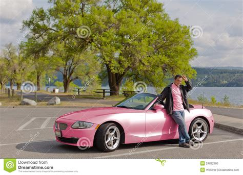 Pretty Pink Car And Matching Driver Stock Photo Image
