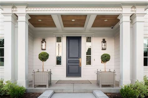 Portico With Dark Blue Front Door Flooring Ideas Design Liquidators Cortlandt Manor Reclaimed Pine Engineered Lumber Toxic List Bamboo Louisville Ky Linoleum Cost Home Depot Diy After 5 Years