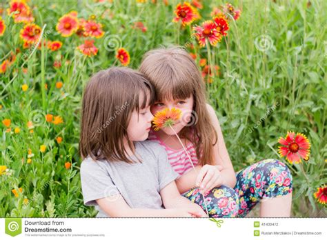 child roses two small children with flowers stock photo image 41430472