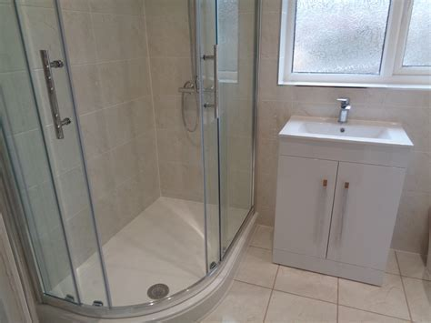 Curved Shower with Modern Storage Sink Unit and Cream Tiles