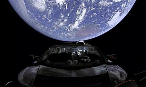 elon musk successfully sends  tesla roadster  space