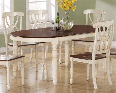 antique white dining table summerglen oval dining table with leaves in antique white 4135