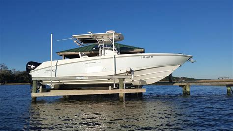 Boston Boat Show Specials by 2006 Used Boston Whaler 320 Outrage Saltwater Fishing Boat