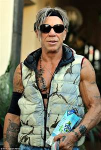 Mickey Rourke can't resist showing off his chiseled ...