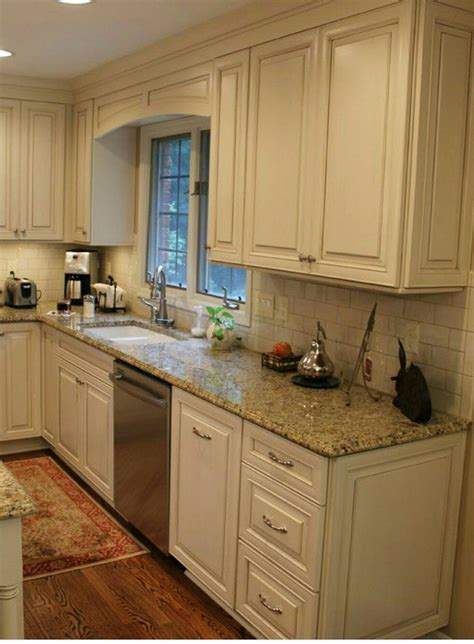 white cabinets with beige countertop white cabinets subway tile beige granite countertops