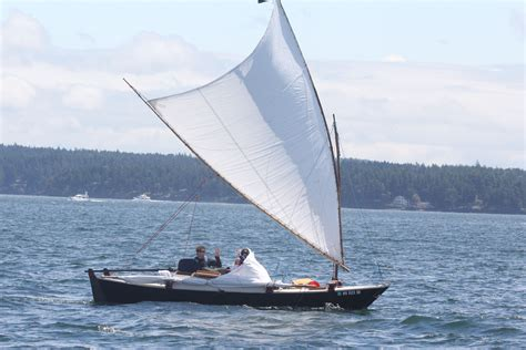 a frame plans performance of a bamboo polytarp crab claw sail on a tiki