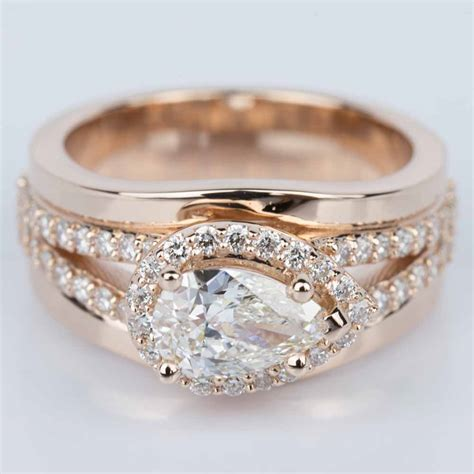 horizontal set pear halo engagement ring in gold