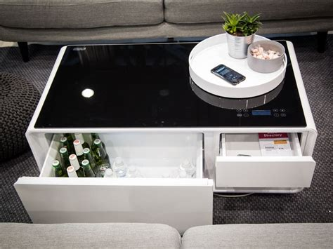 Sobro coffee table and side table overview, walk around, features and the now semi famous bengal cat diesel. Sobro coffee table charges phones, plays tracks and chills drinks - CNET