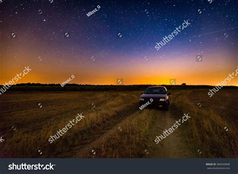Milky Way Over Stubble Field Car Stock Photo