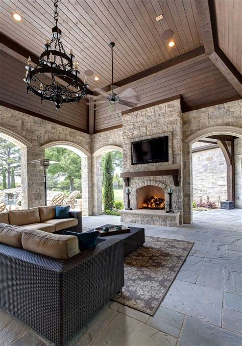 ceiling fans living contemporary urban space fireplace area rustic stone chandelier lifestyle related