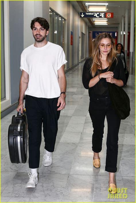 elizabeth olsens boyfriend shares passport  paris