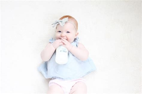 8 Tips To Get Your Baby To Take A Bottle The Girl In The