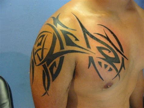 traditional tribal shoulder tattoos