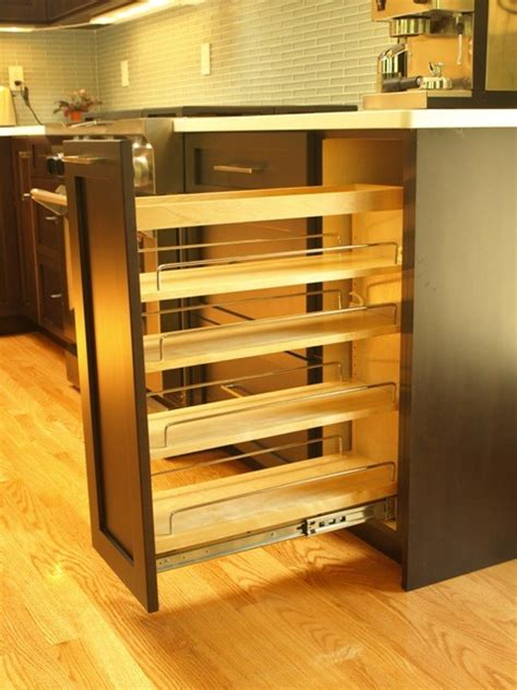 roll out spice racks for kitchen cabinets spice pull out in a base cabinet transitional kitchen 9756