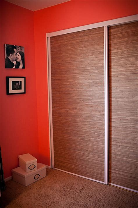grass cloth covered closet doors eclectic home office