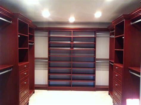 walk in closet in cherry traditional closet