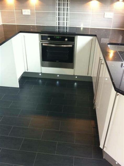 black granite worktop grey  black tiles white gloss