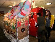20 20 39 S Holiday Decorating Contest Photos ABC News The Ivesons Christmas Office Decorating Contest Christmas Office Door Decorating Ideas Christmas Office Door Cubicle Christmas Decorations Christmas Cubicle Decorating Contest
