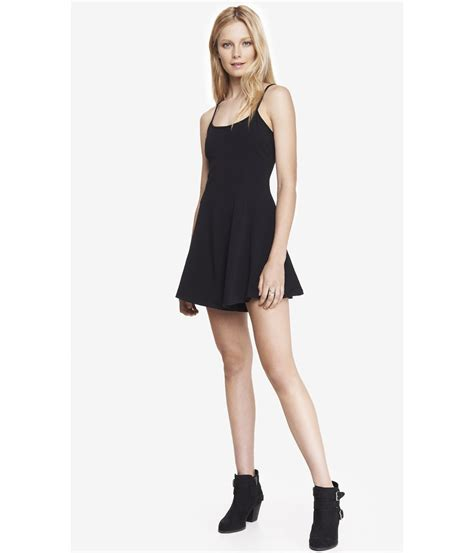 express black stretch cotton skater romper in black pitch black lyst