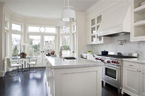 cream kitchen cabinets  white marble countertops