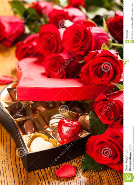 box  chocolate truffles  red roses stock photography