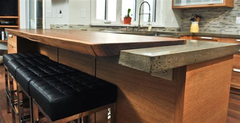 Concrete and Live Edge Walnut Countertop by Yves St