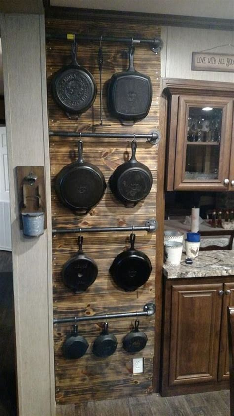 Shiplap Wall Hanging by Hanging Cast Iron Pans On Metal Rods On A Shiplap Wall
