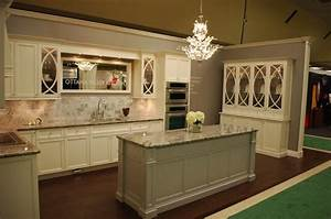 cream cabinets transitional kitchen With best brand of paint for kitchen cabinets with vintage subway sign wall art