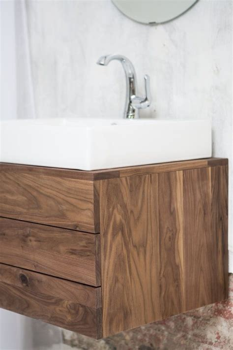 solid walnut floating vanity includes  white porcelain