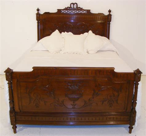 a french walnut antique bed in the manner of henry ii