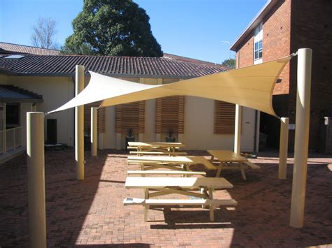 exterior white canvas pool shade with relaxing patio