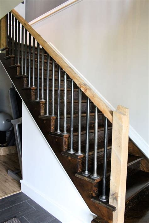 reclaimed wood beam railing and steel pipe balusters for
