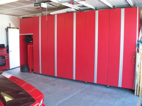 red and black garage cabinets red and white metal new age cabinets on grey garage tile floor