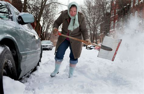 Shoveling Snow Is A Workout, Here's How To Do It Right