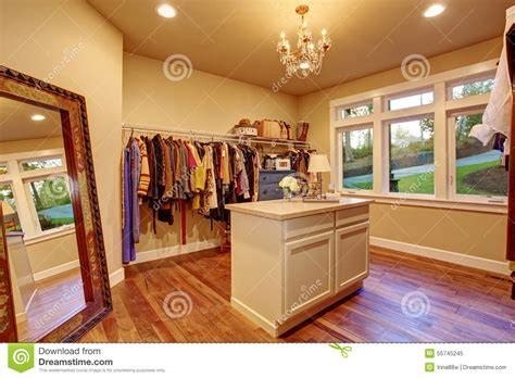 large walk in closet with hardwood floor stock photo