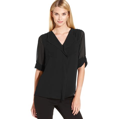 klein blouses calvin klein rolltabsleeve rufflefront blouse in black lyst
